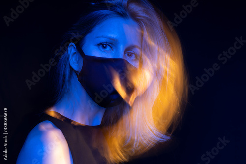 Stunning blonde woman in face mask Slika na platnu