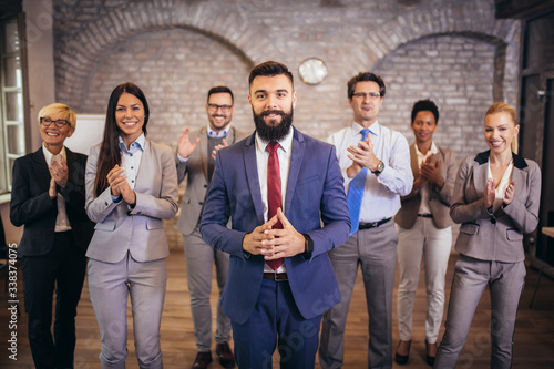 Group of happy business people and company staff in modern office, representing company Fotobehang