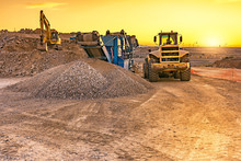 Excavator Collecting Stone In ...