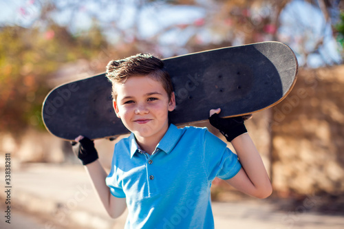 Fotografie, Tablou Kid boy with skateboard. Childhood, leasure and lifestyle concept