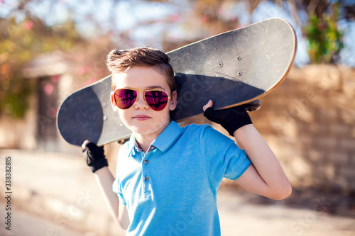 Obraz na plátne Kid boy with skateboard. Childhood, leasure and lifestyle concept