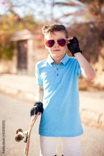 фотографія Kid boy with skateboard. Childhood, leasure and lifestyle concept