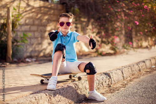 Kid boy with skateboard. Childhood, leasure and lifestyle concept Tablou Canvas