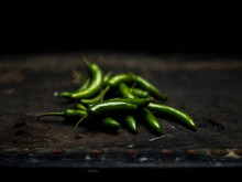 High Angle View Of Green Chili Peppers On Table