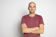 Leinwanddruck Bild - 40 years old bald man in t-shirt isolated on grey