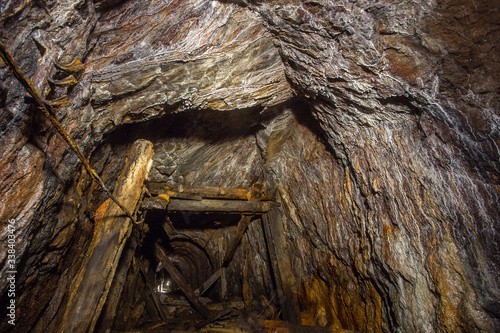 Photo Underground bauxite mine tunnel with collapsed roof