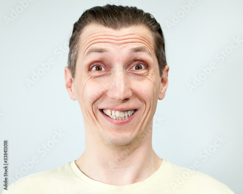 Portrait of a man with a silly wide toothy smile, grey background, emotions seri Canvas Print