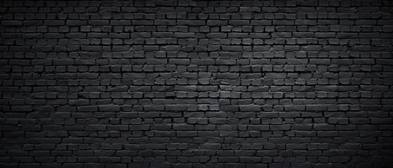 Tekstura crno obojenog opečnog zida kao pozadina ili pozadina