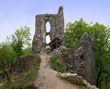 Rubble Of Old Dobra Voda Castle (build In 13th Century) In Slovak Republic. Western Slovakia. Ruin Of Ancient Castle In Forest. Wreck Of Old Stronghold. Remains Of Walls, Towers And Fortification.