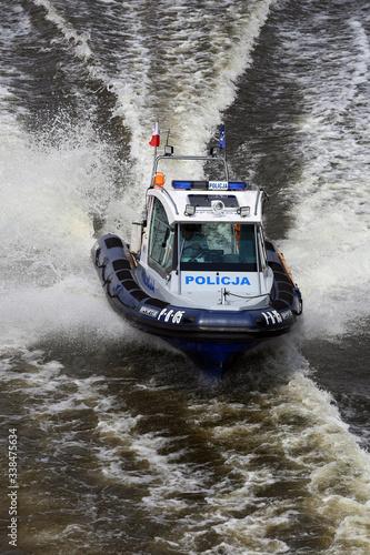 Motorówka policyjna na rzece. Tablou Canvas