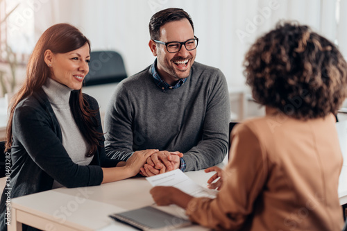 Fototapeta Married couple talking with financial advisor on a meeting obraz
