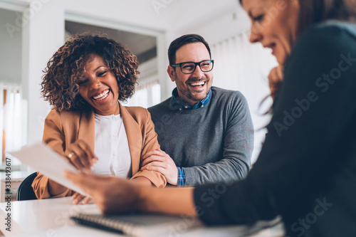 Married couple talking with financial advisor on a meeting Canvas Print