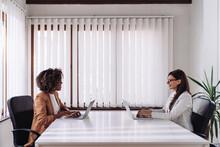 Two Woman Having Business Meet...