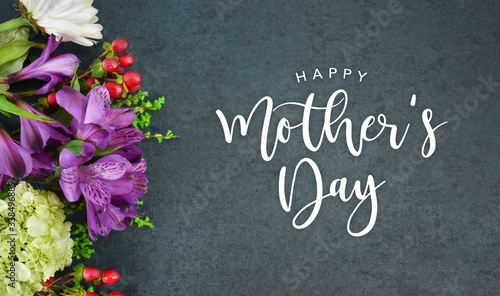 Obraz Happy Mother's Day Calligraphy Text with Beautiful Flowers Bouquet and Black Texture Background - fototapety do salonu