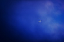 Crescent Moon In Blue Sky
