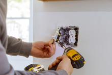 Work On Installing Electrical Outlets.
