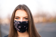 Young Girl In Mask
