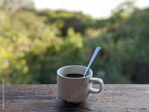 Cup of coffee on wooden table in costa rica Fototapete
