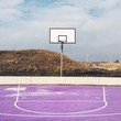 Empty Basketball Court Against Landscape And Clouds