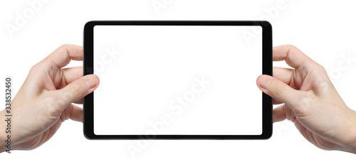 Fototapeta Black tablet in male hands, isolated on white background obraz