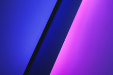 Blank Paper Sheets Rolled In A Neon Purple Lighting Close Up