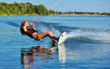 Beautiful Girl Wakeboarding On...