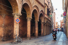 Traditional Portico On Volturno Street In Historic Part Of Bologna City, Italy