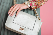 Close Up Of Fashionable Elegant Woman`s Outfit: Trendy Small Green Mint Color Faux Leather Bag, Wearing Stylish White Wrist Watch, Beautiful Rings