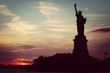 Silhouetted Statue Of Liberty During Sunset