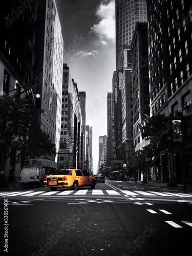 Taxi On Street Along Buildings - fototapety na wymiar