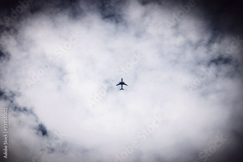 Photo Airplane Against Clouds