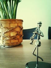 Close-up Of Metal Sculpture On Table