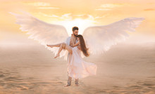 Strong Male Costume Angel Holds Hug Fragile Innocent Woman In Arms. Concept Protection Prayer Security Helper Keeper Love Faith Help Religion. Art Sunset Sky In Desert. Girl And Handsome Man Embracing