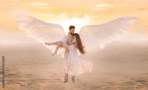 Strong male costume angel holds hug fragile innocent woman in arms Fototapet