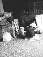 Homeless Men Sitting On Street