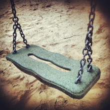 Close-up Of Empty Swing Over Sand
