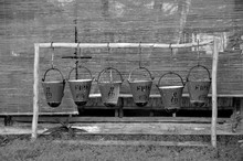 Row Of Fire Buckets Hanging On Bamboo At Yard
