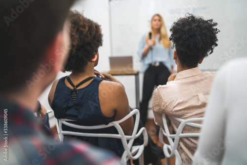 Obraz business woman explaining plan of work in conference. - fototapety do salonu
