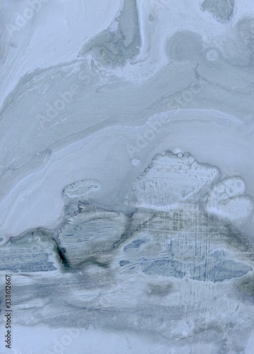 abstract background texture painting in fluid blue gray