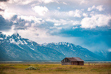 Old Barn Near The Mountains At...