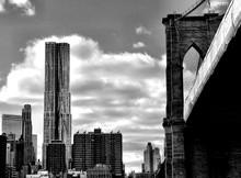 Bridge By Beekman Tower Against Cloudy Sky