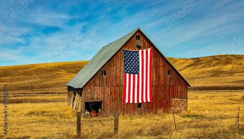 Fotografie, Obraz Showing the USA flag with pride on my barn