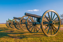 A Row Of Four Cannons At The A...