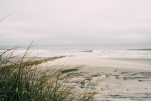 Empty Beach On A Cloudy Day
