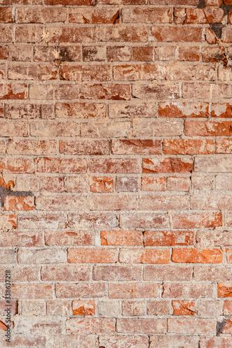 Old and damaged interior shot of a brick wall