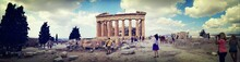 Panoramic View Of Ancient Greece Ruins And Visiting Tourists