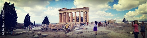 Fotografie, Obraz Panoramic View Of Ancient Greece Ruins And Visiting Tourists