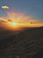 Scenic View Of Landscape At Dunstable Downs Against Sky During Sunset