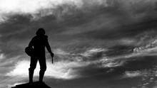 Silhouette Statue Of Diego Velazquez Against Dramatic Sky