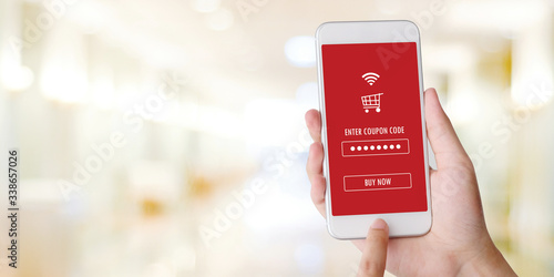 Photo E-coupon, Shopping online, Hand using mobile phone with discount coupon on scree